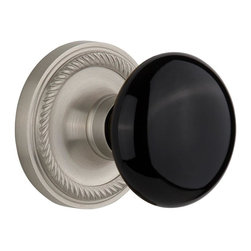 Nostalgic - Nostalgic Passage-Rope Rose-Black Porcelain Knob-Satin Nickel (NW-710033) - Blending rich detail and subdued refinement, the Rope Rosette in satin nickel captures a style that has been a favorite for centuries. Add our timeless, kiln-fired Black Porcelain Knob to create a sophisticated, yet classic look. All Nostalgic Warehouse knobs are mounted on a solid (not plated) forged brass base for durability and beauty.