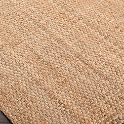 "Jute Woven Rug - Gold - 8' x 10'6"" - Warm, natural fiber tones and a weighty weave make the Jute Woven Rug in Gold a slightly rustic, distinctly interesting addition to your home d�cor.  Ideal for pairing with campaign furniture or jewel-toned textiles, this attractively simple rug offers a sensible, grounded focal point to a room's flow of space.  Its natural fibers were hand-woven in India."