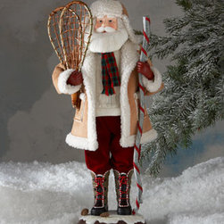 """Horchow - Snowy Mountain Santa - Exclusively ours. Wearing a shearling coat and hat and bearing snowshoes and a walking stick, Santa has come over the river and through the woods to bring your home holiday cheer. Made of fabric and resin. Approximately 13.75""""W x 10.625""""D x 22.625""""T. Imported."""
