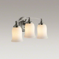 KOHLER - KOHLER Bancroft(R) triple wall sconce - Bancroft accessories capture the elegance of early 1900s American design with their traditional and enduring style. This triple sconce lends a classic touch to the bath or powder room, and can be positioned up or down for a variety of lighting options.