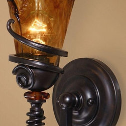 Uttermost - Carolyn Kinder Vitalia 1 Light Wall Sconce - Designer: Carolyn Kinder. Made of Metal, Resin & Glass. Note: Uttermost lighting fixtures are sold only to professional lighting retailers who fully service and stock fixed lighting products. Assembly instructions. 6 in. W x 8 in. D x 14 in. HHand wrought oil rubbed bronze metal curls around heavy hand made glass. Its amber tonalities are key in this exciting mix of materials.