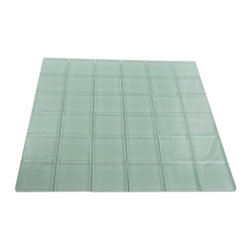 "Loft Seafoam Polished Glass Tiles - LOFTSEAFOAM POLISHED2"" X 2\"" GLASS TILES 2\""x 2\"" glass tiles in a soft color seafoam green color. These glass tiles are will add durable lasting beauty, and value to your bathroom, kitchen, fireplace or pool installation. Sold by the sheet, sheet size 12x12 Size: ? Length: 2\"" ? Width: 2\"" ? Projection: 8mm Finish Shown: Frosted Seafoam Green, the color is painted on the back of the tile so it will not scratch or chip off."