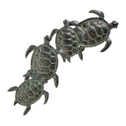 Holly & Martin - Darwin Wall Art - Bring the lagoon home with this lovely sea turtle wall art. This hand painted sculpture is crafted from metal and features four turtles traveling together. The finish consists of varying shades of green and each piece is unique. Everyone is sure to pay compliments on your adorable new turtle art.