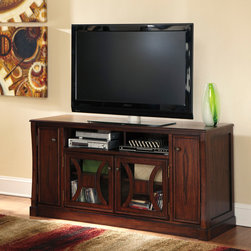 Signature Design by Ashley - Signature Designs by Ashley 'Devrik' Warm Brown Large TV Stand - Casual and contemporary,this stately Devrik TV stand from Ashley Furniture features a hardwood construction with a medium brown finish. Compete with adjustable shelves and four cabinet doors,this generous storage cabinet is sure to keep you organized.