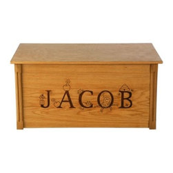 Wood Creations Amber Finish Thematic Lettering Toy Box - Our Laser Engraved Thematic Lettering Toy Box is hand-crafted with a solid red oak frame and oak veneer paneling stained with a warm amber finish. The box is finished with a satin clear topcoat to provide protection while letting the natural wood grain shine through. This large-sized box is safety-hinged so that the lid stands safely open at any height. The front of the box features a laser-engraved personalization. The Thematic lettering is educational because each letter has a character that begins with that letter.. Up to 11 characters can be used for personalization. The laser engraving has a resolution of 300dpi (dots per inch). This means it has the same detail as a magazine photograph. This results in high-quality clarity and detail. Assembly Required. The Thematic Lettering Toy Box comes ready to assemble and requires a regular and Phillips screwdriver. About Wood CreationsWood Creations Inc. a family-owned business produces handcrafted toyboxes and blanket chests in Bismarck North Dakota U.S.A. Wood Creations also offers manufactured toyboxes which have some of the same great personalization features as the handcrafted toyboxes at a more affordable price. Committed to customer satisfaction Wood Creations' toyboxes and blanket chests are heirloom quality and built to last a lifetime.