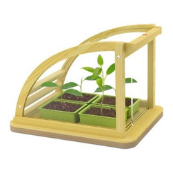 HABA Toy Hape Eco Greenhouse In Bamboo - Teach kids how to grow plants and about nature with this eco-greenhouse. I love its simple, natural design. Made with bamboo, the the greenhouse opens from the top, has two sliding doors and includes four grow trays.