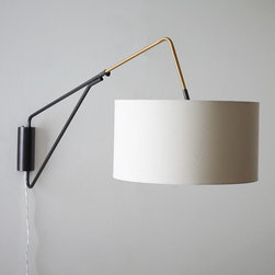 Midcentury Overarching Wall Sconce - This wallmount light has beautiful midcentury appeal. I'd flank the bed with a set for a clean-lined look.