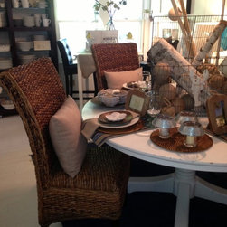 Don't call it wicker! - These woven chairs are one of our favorites. They slide right up to the table in any decor - traditional, transitional ... even contemporary! The texture and the color of the weave add incredible warmth to any table ... any dining room or kitchen. They're comfy, hold up to serious wear and clean with warm soap and water.