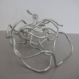 Untitled, 2010 by Thór Vigfússon - This abstract aluminum sculpture by Thor Vigfusson showcases the artist's experiments with geometric abstraction. The artist has twisted aluminum wire into a serpentine tangle that plays with negative space. Here, Vigfusson ventures into three dimensions, a bold departure from his signature translucent wall pieces.