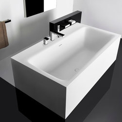 Gessi Bathtubs -- Rettangolo - Freestanding Rettangolo bathtub with side ledge or without side ledge features a pure rectangular shape and minimalist lines that are ideal for modern and eclectic spaces.  Faucets can be mounted on the ledge.