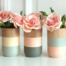 Painted Wooden Vases by Shade on Shape - It's true that kids can be rough on decor, but that doesn't mean you must go without pretty things, like fresh flowers on the table. These little hand-painted wooden vases from Etsy shop Shade on Shape are adorable and so durable that you could put a few on the kids' table.