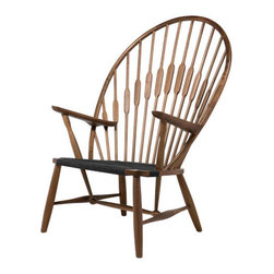 Spindle Back Sun Chair - Make relaxing a stylish endeavor. Nature takes over, sweeping up the slatted bulrush-inspired oversized back. A great seat for any sunroom, indoor patio, or any room warm with natural light.
