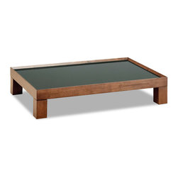 Bryght - Evan Brown Glass Cocoa Coffee Table - The Evan coffee table displays a unique disposition with its sturdy chunky legs and slightly slanted raised wood edging. A handsome piece that is sure to sit well in both cozy and formal settings