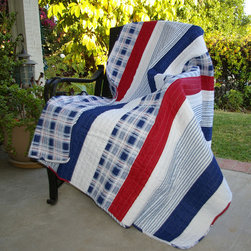 None - Nautical Stripes Quilted Throw - This Americana-style quilted throw is the perfect modern touch to any nautical themed room. Made from 100 percent cotton to make it soft, the reversible throw features an all-over plaid design on one side and a striped design on the other.