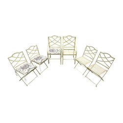 Pre-owned 1930s Wrought Iron Garden Bistro Chairs - Set of 6 - A beautiful set of 1930s vintage wrought iron garden/bistro chairs. The set includes 4 folding chairs and 2 armchairs. They were recently used as dining chairs in a Santa Barbara home and as part of a bistro table set in yard.    This set has a warm yellow distressed paint finish and comes with cushions (probably not original but fitting none the less). The cushions are upholstered in cotton fabric with a black & white farm scene print and are in great condition (no tears, fraying, etc.). They're incredibly thick, dense, & comfortable and have been professionally cleaned even though one side shows darkening due to use & age (easily concealed by flipping over).    Use the set indoor or out, with or without cushions. It's perfect for any country kitchen, breakfast nook, garden/patio seating, etc. The set looks amazing with a variety of different tables - tile, glass, light woods (especially birch, ash, white pine), etc.
