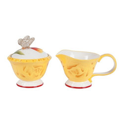 Fitz and Floyd - Fitz and Floyd Flower Market Sugar And Creamer Set - 29-944 - Shop for Condiment Supplies from Hayneedle.com! Italian rustic color and artisan-pressed surface detail give the Fitz and Floyd Flower Market Sugar and Creamer Set a distinctively sunny character in kitchen or dining room - the perfect companion with which to start or end your day. Crafted from durable earthenware this lovely set is accented with a butterfly and parrot tulip lid and features hand-painted colors of sepia white Naples yellow and Sunset red.About Fitz and FloydFitz and Floyd is recognized worldwide as a leader amongst the style- and quality-conscious. For 50 years their unique designs have made them the leader in the purveyor of hand-painted ceramic dinnerware tableware accessories giftware and collectibles. All Fitz and Floyd pieces are easy to spot. Each piece is distinctively hand-crafted by artisans from the drawing board to the sculpting wheel and kiln.The company's Dallas-based studios are renowned for producing over 500 unique designs per year. Creations range from presidential dinnerware for the White House or a tea service for Her Majesty Queen Elizabeth II to the perfect centerpiece for your table and each design is lovingly crafted in the highest quality. Meticulous craftsmanship and exquisite detail make every Fitz and Floyd piece a treasured heirloom-quality gift.