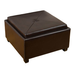 Great Deal Furniture - Maddison Brown Storage Tray Top Ottoman - The Maddison storage tray top ottoman is triple-threat of ottomans. It offers users extra seating and a built in tray top. Designed in smooth chocolate brown bonded leather, the Nathan features a double sided top that can adjust to your needs. Use the top to prop your feet or for extra seating. Flip the top and use the tray to serve food or beverages for entertaining. Open the top, and use the inside for extra storage needs.