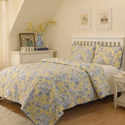 Waverly Picture Perfect 3 Piece Quilt Set - Freshen up your bedroom simply by adding the Waverly Picture Perfect 3 Piece Quilt Set. This set uses sunny yellow and classic blue-and-white flowers to create the look. A double-stitched detail adds the finishing touch. The set includes a quilted coverlet and two pillow shams. All pieces are machine washable and may be tumbled dry on low.Quilt Dimensions:Queen: 90L x 90W in.King: 90L x 106W in.About Ellery HomestylesOffering curtains, bedding, throws, and specialty products, Ellery Homestyles is a leading supplier of branded and private-label home-fashion products. Their products deliver innovation in fashion, function, and design and include names like Eclipse™, Curtainfresh™, SoundAsleep™, ComfortTech™, Vue™, and Waverly. Their 357,000 square foot facility in Lumber Bridge, North Carolina includes a high-speed pillow filling operation with a capacity of approximately 40,000 pillows a week.