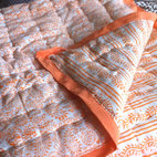 "Tilonia Home: King Quilt - Hanuman Paisley & Centipede Stripe in Pumpkin - Jaipuri ""razai"" are wonderfully light, but delightfully warm quilts designed for the swings in Rajasthan desert temperatures from blistering day to chilly nights. Block printing on 100% cotton voile fabric with finely combed cotton filling."