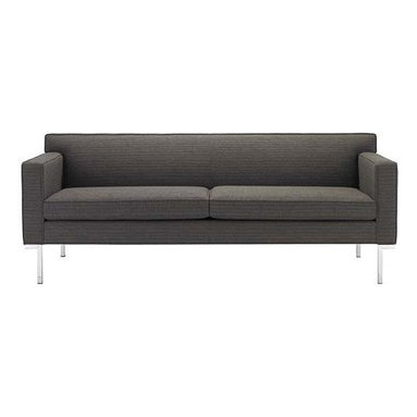 Design Within Reach - Theatre Sofa   Design Within Reach - Modern sofas often tout minimalist appeal, but few can also claim the comfort of Ted Boerner's Theatre Collection (2001). The Sofa, Two-Seater Sofa and Armchair are all designed to accommodate the human body with studied proportions and simple geometry. The result is comfort that stems from its form, rather than excessive layers of stuffing and upholstery. The gentle angling of the backrest, full seat depth, and elevated armrests are eminently suited to living rooms or reception areas. Boerner's signature artisan details are evident throughout these handcrafted pieces. A gleaming chromed steel base runs the entire depth of the design, and welted seams lend strength and definition to the upholstery. Made in U.S.A. DWR Exclusive.