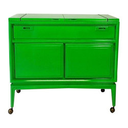Pre-owned Green Lacquered Mid-Century Modern Bar - A glorious green Mid-Century Modern bar on casters. The bar features two fold-out panels that open up to a laminate top bar. The bar has one drawer and two doors that open up to a lacquered inside cabinet. It is finished on all 4 sides.     60 in. long with the wings folded out.