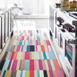 "FLOR - Embrace color with this striking runner using a mix of Parallel Reality in Purple, Pink, Teal, Burgundy and Green. Build a rug of any size with this set of 5 Parallel Reality squares. Simply add sets together to expand your rug. $70.00 / 5 squares / (1' 7"" x 6' 7"")"
