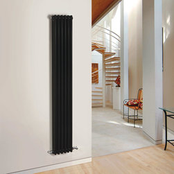 Hudson Reed - Traditional Column Radiator Cast Iron Style High Gloss Black 71 x 10.6 - This cast iron style radiator, with a high quality high gloss black powder coat finish (RAL 9005), has 6 vertical triple columns that give a massive heat output of 1,452 Watts (4,951 BTUs), ample to warm a room quickly and effectively.  When combined with a set of modern valves, this up-to-date version of a classic vertical radiator design is an ideal complement to contemporary settings, but also fits in equally well with traditional décor. This versatile radiator is compatible with all domestic central heating systems, will connect with your existing pipe work and is supplied complete with a wall mounting kit. For a truly authentic look, combine this traditional-style radiator with a Hudson Reed floor mounting kit (TRUSH017).  Traditional Column Radiator Cast Iron Style black 71 x 10.6 Details   Dimensions: (H x W x D) 71 (1800mm) x 10.6 (270mm) x 4 (100mm) Projection When Fitted: 5.1 (130mm) Output: 1,452 Watts (4,951 BTUs) Material: Steel Finish: High Gloss Black Powder Coat (RAL 9005) Columns: 6 x 3 Wall Mounting Brackets Included Optional Floor Mounting Kit Available - See Essential Extras Above Please note: Angled Radiator Valves are required, please choose either modern or traditional radiator valves.  Please Note: Our radiators are designed for forced circulation closed loop systems only. They are not compatible with open loop, gravity hot water or steam systems.