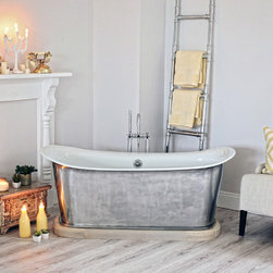 Sunshine - The Bath Works St. Lyon bathtub with a custom made hardwood Plinth. The tub has a Satin polished exterior and the wooden plinth is American sourced Ash with a Pickled finish. Set in a very luxurious and feminine room with yellow and golden accents to bring out the 'Sunshine'. An inviting room to bathe and relax. Photo taken by The PhotoGraphix of Franklin TN