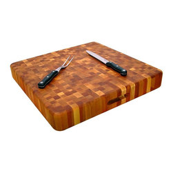 Catskill - Super Slab With Finger Grooves Chopping Block Multicolor - 12020 - Shop for Cutting Boards from Hayneedle.com! Beautiful and rugged all at once the Super Slab with Finger Grooves Chopping Block is built tough yet looks nice on any kitchen counter. The use of end-grain wood is ideal for a cutting board because it won't dull your knives. This block is 3 inches thick so it can handle heavy cutting and pounding of all sorts. It features a protective oil finish and finger slots on two sides for easy moving and handling. It's also reversible so when one side is dirty simply flip it over. This fine chopping block is made in the USA. This item is made from oil-finished natural yellow birch hardwood which is indigenous to the Northeastern U.S. and ranges in color from blond to a darker walnut shade; the natural variation in color allows this chopping block to coordinate with your existing decor.Catskill Craftsmen's Eco-friendly PracticesCatskill Craftsmen is committed to protecting the environment through responsible forest management and manufacturing practices. Located in the Catskill Mountains of upper state New York Catskill Craftsmen plays a role in maintaining the health of the New York City watershed. This watershed provides clean water for New York City and other communities in the area. Healthy well-managed forests are better able to filter pollutants from entering streams and rivers which preserves the quality of watershed resources. With this goal in mind the company supports the efforts of the Watershed Agricultural Council (WAC). With the WAC Catskill Craftsmen encourages lumber suppliers (family forest owners and public land managers) to make wise harvesting decisions and control erosion in order to safeguard water quality.Other efforts to protect the environment include using sustainable wood sources and reducing wood waste. Catskill Craftsmen's manufactured items are made from naturally self-sustaining non-endangered North American hardwoods primar