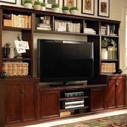Logan Media Suite with Bridge - For a true media space, you can't go wrong with a suite. Keep the shape traditional, and accessorize it with books, baskets and plants — keep the movies and controllers hidden.