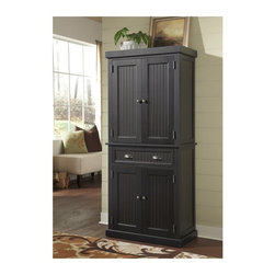 Home Styles - Home Styles Nantucket Pantry - Distressed Black - 5033-69 - Shop for Pantries from Hayneedle.com! From boxes of cereal to rolls of paper towels the Home Styles Nantucket Pantry - Distressed Black keeps your kitchen staples organized and within easy reach. Constructed of hardwood solids and engineered wood this multi-purpose storage pantry has a sanded distressed black finish for a weathered look. It features a spacious storage drawer and two cabinet doors that each open to two adjustable shelves. This versatile pantry boosts your kitchen storage holding everything from mixing bowls and dish towels to cookbooks and canned food. Antique brushed nickel hardware and recessed panel doors enhance the warm classic style.About Home StylesHome Styles is a manufacturer and distributor of RTA (ready to assemble) furniture perfectly suited to today's lifestyles. Blending attractive design with modern functionality their furniture collections span many styles from timeless traditional to cutting-edge contemporary. The great difference between Home Styles and many other RTA furniture manufacturers is that Home Styles pieces feature hardwood construction and quality hardware that stand up to years of use. When shopping for convenient durable items for the home look to Home Styles. You'll appreciate the value.