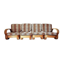 "Paul Frankl - Pre-owned Four Piece Band Bamboo Sectional Sofa - This four piece banded bamboo sectional sofa has a low profile and high style! Although unmarked, it's in the manner of Paul Frankl, and slipcovered in leopard fabric. The four pieces can be used alone or can be configured as desired.    Seat: 23""W x 15""H; arm, 21""H.   Settee configuration: 57""L x 33""W x 29""H; seat, 23""W x 15""H; arm, 21""H.   Individual side chair: 23""L x 33""W x 29""H; seat, 23""W x 15""H."