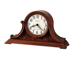 Howard Miller - Anthony Mantel Clock - Instant class just became a possibility with this quality find. Gorgeous wood slopes into a intricately detailed base. Cast iron metal hands point out the hour uniquely with this piece as it perches pristinely from any night table, bedside or mantel. * This 77th Anniversary Edition tambour mantel clock is rich in details.. A beaded dentil molding surrounds the base, accenting the carved side scrolls and burl veneered front panel. Beneath a convex glass crystal, the aged dial offers black Arabic numerals, black serpentine hour and minute hands, and a special 77th Anniversary inscription. Quartz, dual chime movement plays Westminster or Ave Maria chimes with strike on the hour, with optional 4/4 chime feature which plays 1/4, 1/2, and 3/4 chimes accordingly. Features volume control and automatic nighttime chime shut-off option. Finished in Oak Yorkshire on select hardwoods and veneers. H: 8.5 in. (21 cm). W: 15.75 in. (40 cm). D: 5.25 in. (13 cm)
