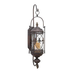 Aspire - Fleur De Lis Candle Lantern Wall Sconce - Here is the perfect way to add mood lighting to your space with this candle lantern. The antique brown metal candle holder features a fleur de lis design and a metal plate for mounting onto the wall. Metal. Color/Finish: Antique Brown. Holds pillar candles up to 4 in. wide (not included). 30 in. H x 10 in. W x 12 in. D. Weight: 4 lbs.
