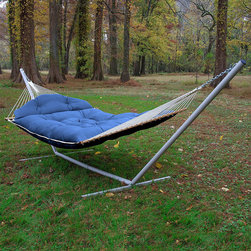 Frontgate - Tufted Hammock, Patio Furniture - Well-designed hammock offers advanced weather resistance and remarkable softness. Tufted pillow top, quick-dry bed is crafted from exceptionally strong, solution-dyed DuraCord®, one of the industry's most colorfast fabrics, layered over a plush center of polyester hollowfill fiber. Bed reverses to a solid natural hue. Spreader bars crafted from sustainably harvested South American cumaru teak that naturally weathers to a stately silver-gray. DuraCord® ropes are made from 3-ply synthetic materials that are soft as cotton. Whether at the seaside or on the family farm, there's nothing quite as comfortable and relaxing as lounging in the afternoon breeze in a swaying hammock. Especially if that hammock is as extraordinary as ours. Every detail of our tufted-top hammock has been carefully considered, from the soft-as-cotton plush bed built for two, to the texture of the rope, the sustainable teak stretcher bars, and the durable hardware. So, get ready to set up your oasis in the shade of two trees or between beams on a porch or deck. Add a matching pillow (sold separately) for extra contentment.. Tufted pillow top, quick-dry bed is crafted from exceptionally strong, solution-dyed DuraCord, one of the industry's most colorfast fabrics, layered over a plush center of polyester hollowfill fiber. . . DuraCord ropes are made from 3-ply synthetic materials that are soft as cotton. Equipped with the industry's heaviest steel hardware, all zinc plated to retain polished chrome shine and ward off rust. One-piece adjustable ring-and-chain hook makes for easy set up. Two chains and tree hook hardware included. Hammock stand and pillow sold separately. Made in the USA. 1-year manufacturer warranty.