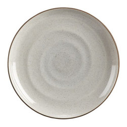 """18th St. Salad Plate - Modern and restrained in form, expressive and rustic in glaze. The artisan's hand is authentically reproduced in this stoneware pattern designed exclusively for Crate and Barrel by ceramic artist and designer Kathy Erteman at her 18th Street studio in New York City. A contemporary matte black exterior contrasts the rustic beauty of a shiny, speckled white glazed interior ringed with the subtly raised spiral associated with hand-thrown pieces. A raised clay rim features a sandy glaze that evokes the feel of exposed terra cotta. To capture the artisan look of this dinnerware, Erteman modeled prototypes to true scale by hand with her original glazes as reference for production. In the words of the designer, """"When making tableware, I consider design and the rigors of daily use. The spirit of my hand in these pieces is modest, to harmonize with and act as a support to the prepared ingredients."""""""