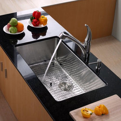 Kraus - Kraus KHU100-32-KPF2110-SD20 Single Basin Undermount Kitchen Sink with Faucet Mu - Shop for Kitchen from Hayneedle.com! With everything you need to run your kitchen smoothly the Kraus KHU100-32-KPF2110-SD20 Single Basin Undermount Kitchen Sink with Faucet has an innovative design you'll adore. Its single handle offers smooth operation and doubles as a strong sprayer to rinse produce and dishes. The set is made to take on corrosion being made from durable stainless steel.Product SpecificationsBowl Depth (inches): 10Weight (pounds): 34Low Lead Compliant: YesEco Friendly: YesMade in the USA: YesHandle Style: LeverValve Type: Ceramic DiscFlow Rate (GPM): 2.2Spout Height (inches): 7.5Spout Reach (inches): 8.5About KrausWhen you shop Kraus you'll find a unique selection of designer pieces including vessel sinks and faucet combinations. Kraus incorporates its distinguished style with superior functionality and affordability while maintaining highest standards of quality in its vast product line. The designers at Kraus are continuously researching and exploring broader markets seeking new trends and styles. Additionally durability and reliability are vital components at Kraus for developing high-quality fixtures. Every model undergoes rigorous testing and inspection prior to distribution with customer satisfaction in mind. Step into the Kraus world of plumbing perfection. With supreme quality and unique designs you will reinvent how you see your bathroom decor. Let your imagination become reality!