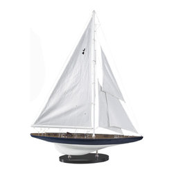 """J-Yacht Rainbow 1934 - The J-Yacht Rainbow 1934 measures 25.5""""L x 4.25""""W x 33.5""""H. J-Yachts are the most famous historical racing yachts. The top of it's hull is painted blue and the bottom is painted white. The quality of this ship is unsurpassed. It has been made with the highest quality parts such as: fabric sails with detailed stitching and rigging, solid brass antiqued hardware made from individual molds and decking, a japanned lacquer ware stand with chrome fittings and hulls built plank on frame like the original dockyard models. The plans and drawings for this ship were researched in the archives of museums and national libraries. The ship was completely hand made by skilled craftsmen and women. It can be found in the Oval Office at the White House, Wall street offices and private libraries. It comes numbered, dated  with a certificate."""