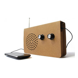 SuckUK - Cardboard Radio - The Cardboard Radio boasts an extremely simple design and is environmentally friendly. The radios form is simple and concise and adds to its no nonsense appeal – which is a shame, since we can no longer roll out all the bad puns we had planned. The included audio cord allows you to hook up your iPod or MP3 player so that you can play your own personal playlist.