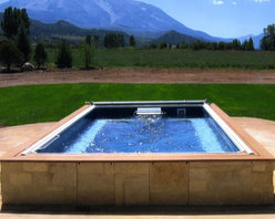 Original Endless Pools® - Imagine emerging from your Endless Pool swim to this magnificent view! In this deceptively simple installation, shrewdly chosen wood coping and brick skirting bring a sun-baked feel to the most cooling element in the landscape.