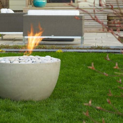"""Soba Concrete Fire Pit - Soba firebowl is designed to have a smaller footprint than Miso, but no less impact. With a 28"""" diameter and standing 16"""" tall, Soba has a serene, but fiery personality that is equally at home at the centre of attention as it is as an accent torch in the garden or poolside."""