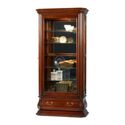Jasper Cabinets - Bombay Style Side Entry Curio Cabinet w Locki - A Bombay style drawer adds an element of drama to this striking curio cabinet, featuring beveled glass doors and glass side panels. The unit is made of wood in dark cherry finish and is enhanced by a mirrored back and halogen touch lights that allow your heirlooms to be beautifully showcased. Bombay style drawer with dovetail front and back. Hand rubbed. Mirrored back. Door locks on both side doors. Five adjustable glass shelves with plate grooves. Halogen lighted with touch light and dimmer. One full size drawer at bottom. Beveled glass doors and sides. Adjustable floor levelers. Made from solid wood and veneers. Assembly required. 17 in. W x 38 in. L x 80 in. H (176 lbs.) Jasper Cabinet's large selection of curios are made to meet our long standing tradition of excellence.