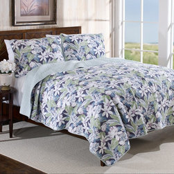 Tommy Bahama - Tommy Bahama Newport Blue Reversible Cotton Quilt Set - 201556 - Shop for Quilts from Hayneedle.com! When you can t have fresh flowers have the next best thing - the Tommy Bahama Newport Blue Reversible Cotton Quilt Set. Crafted with 100% cotton this lofty ensemble includes a quilt and one or two coordinating shams. Each piece boasts a fresh blue and white floral print. The prewashed fully reversible quilt has a contrasting-but-coordinating back side too for a different look. Choose from available sizes - each set is machine washable for easy care.Bedding Set Components:Twin: Quilt 1 shamFull/Queen: Quilt 2 shamsKing: Quilt 2 shamsQuilt dimensions:Twin: 88L x 68W in.Full/Queen: 90L x 90W in.King: 104L x 96W in.About Tommy Bahama HomeTommy Bahama started as an upscale men's casual sportswear line and has transformed into a signature brand expanding their product line to accommodate women's apparel golf wear footwear home furnishings and even retail and restaurant compounds. The Tommy Bahama brand represents quality products with fashion forward designs that are available at an affordable price. Their signature island-lifestyle designs suggest a modern style with an emphasis on comfort and relaxation.