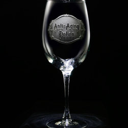 """Crystal Imagery, Inc. - Anti Aging Potion Wine Glass Set, Engraved Stemware - Engraved Anti Aging Potion Wine Glass is a humorous birthday gift for wine lover. What woman wouldn't want to sip her favorite vino from a glass that says it will keep you from aging?! Deeply carved using our sand carving technique, each wine glass is meticulously custom made to order making it the perfect gift for those seeking unique gift ideas for wine lovers - men and women alike. At 9"""" high by 3.5"""" wide, our wine glasses hold 19 oz. A set of these etched wine glasses will be the favorite gift at any special gift giving occasion. Dishwasher safe. SOLD AS A SET OF 4 WINE GLASSES."""