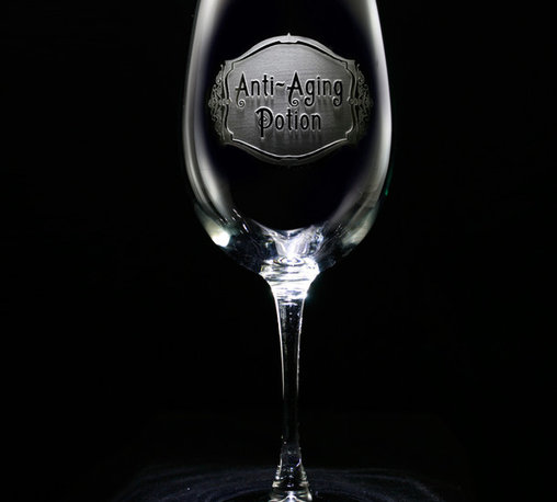 "Crystal Imagery, Inc. - Anti Aging Potion Wine Glass Set, Engraved Stemware - Engraved Anti Aging Potion Wine Glass is a humorous birthday gift for wine lover. What woman wouldn't want to sip her favorite vino from a glass that says it will keep you from aging?! Deeply carved using our sand carving technique, each wine glass is meticulously custom made to order making it the perfect gift for those seeking unique gift ideas for wine lovers - men and women alike. At 9"" high by 3.5"" wide, our wine glasses hold 19 oz. A set of these etched wine glasses will be the favorite gift at any special gift giving occasion. Dishwasher safe. SOLD AS A SET OF 4 WINE GLASSES."