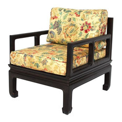 """Pre-owned Antique Chinese Rosewood Low Armchair - Antique carved Chinese low armchair. Solid Rosewood floating panel seat. Open arm chair design with carved chow legs. Comes with a floral pattern chair pads. In excellent condition believed to be circa the 1950's. Very heavy and solid construction. One of a kind design with tight seams.     Seat height 12""""."""
