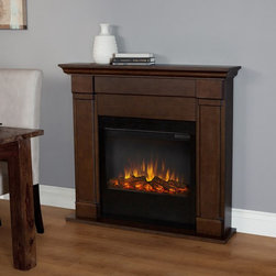 Real Flame - Real Flame Lowry Slim Line Electric Fireplace - Vintage Black Maple - 7990E-VBM - Shop for Fire Places Wood Stoves and Hardware from Hayneedle.com! Transform any room into a homey living space with this Real Flame Lowry Slim Line Electric Fireplace - Vintage Black Maple. This compact electric fireplace plugs into any standard outlet and extends only 9.3 inches from the wall for a built-in look. The fire glows with a bright realistic LED look. The brightness as well as the heat are adjustable. It also includes a timer and a remote control. It Vintage Black Maple finish fits into your home perfectly.About Real FlameReal Flame is the original premium gel fuel designed for use with ventless gel fireplaces and accessories. For more than 25 years Real Flame has been the leading alcohol-based gel fuel on the market. Real Flame gel is an environmentally friendly non-toxic clean-burning gel that doesn't leave any soot smoke or ashes behind - so there's no messy cleanup. Best of all Real Flame creates a robust bright yellow orange and red flame that crackles just like a log fire. Made in the U.S.A.Real Flame is made from pure premium-grade isopropyl alcohol and thickeners to enhance stability. Real Flame is the safest most viscous (thick) gel fuel available on the market. It is not liquid and will not break down separate or liquefy as quickly as other brands. To maintain the integrity and stability of Real Flame all Real Flame gel cans are specially treated to prevent rusting on the inside. Environmentally FriendlyReal Flame is a safe clean-burning gel that is regularly tested by numerous independent labs. Air-quality results while burning Real Flame gel fuel fall well below the standards established by the Occupational Safety and Health Administration (O.S.H.A.) and the Environmental Protection Agency (E.P.A.). Each batch of Real Flame gel fuel production is closely monitored to ensure the highest quality. EfficiencyEach can of Real Flame gel fuel is designed to burn for up to 2.5 to 3 hours. If you wish to create a fire for a shorter period simply extinguish the flame and re-cap the can. Reuse any remaining gel fuel for your next fire. For each fire you may use one to three cans of gel fuel at a time depending on the size of fire you wish to create. When compared to cartridge-style cans one can of Real Flame gel fuel is available at a fraction of the cost. Growing PopularityMillions of consumers can't be wrong. Loyal customers have made Real Flame the leading gel fuel on market today. Don't be fooled by unscientific consumer polls. Real Flame is the original and best-selling gel fuel available and has been on the market the longest. Never settle for any other gel fuel in your Real Flame fireplace or accessories.