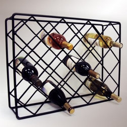 J & J Wire Rectangle Diamond Wine Rack - You may not have a full wine cellar but the J & J Wire Rectangle Diamond Wine Rack displays up to 18 bottles of wine in simple style. Diamond shapes criss-cross the rectangular frame creating a functional yet elegant storage solution. This freestanding unit is proudly made in the USA from wrought iron with a black powder-coat finish.About J & J Wire Inc.Located at the Industrial Park in Beatrice Nebraska J & J Wire Inc. started 25 years ago as a wire-forming business manufacturing mostly houseware items. Since then the company has grown into a metal fabrication business serving customers in many different manufacturing sectors in the United States and Canada. From quilt racks to wine racks J & J Wire is committed to creating handmade works of art at affordable prices.