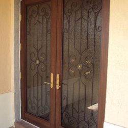 Palm Beach County - Impact Entry Door were designed to imitate the look of wood, yet eliminating the high maintenance, swelling, and cost.
