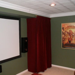 Raceway Crown Molding Hides Cables and Wires - The Raceway Crown Molding gives an elegant finished and elegant touch to this home theater set up. Wires and cables are neatly bundled up and hidden within the classic interior of the crown molding.